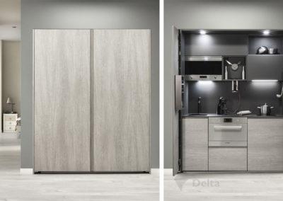 C12 Cocina completa en 180cm. Puertas escamoteables, armazón en antracita, altos con puertas abatibles con sistema  de apertura eléctrico. Encimera de porcelánico gris pizarra.