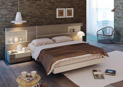 DM8 Dormitorio línea moderna en chapa de madera en color nogal combinado en color crema, con repisas con luz, mesillas de dos cajones irregulares, bancada combinada en crema, posibilidad de sinfonier, cómoda y armario a juego.